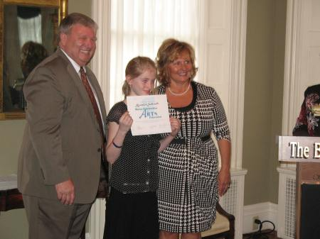Camden-Rockport Elementary School student Alexandra Southworth, grade 3 with Steven Pound and the First Lady
