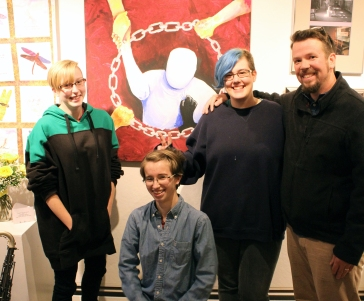 "Exhibiting Cony students with art teacher Jason Morgan in front of their painting, ""Breaking the Chain"" now on show at Harlow's, ""Transforming Violence II""Danforth Gallery"
