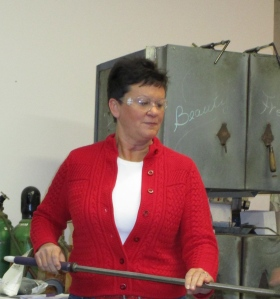 Julie at Atlantic Art Glass in Ellsworth learning how to blow a glass ball