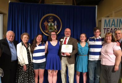 Congratulations Music Educator Andy Forster, Kennebec County Teacher of the Year at the Hall of Flags awards ceremony posing here with family, friends, colleagues, and students