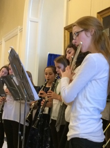 Under the direction of music teacher Cynthia Streznewski, musicians from Woolwich Central School perform at the State House for the celebration
